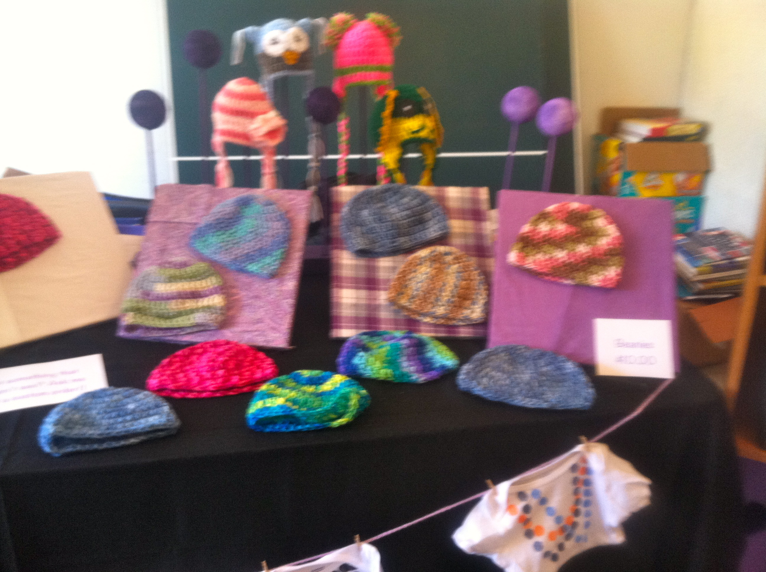 Diy crochet craft fair booth hat displays family bugs for Crochet crafts that sell well